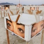 A participant looks at art works on the playa at sunrise, during the 2013 Burning Man arts and music festival in the Black Rock desert of Nevada
