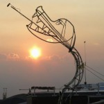 A sculpture of a fire breathing dragon is seen at sunrise during the 2013 Burning Man arts and music festival in the Black Rock Desert of Nevada