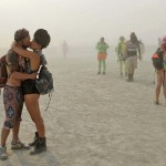 A couple kisses at Burning Man. (Andy Barron/The Reno Gazette-Journal)