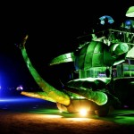 Mutant vehicles drive across the Playa during the Burning Man 2013 arts and music festival in the Black Rock Desert of Nevada