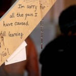 Messages are left by participants at the Temple of Whollyness during the Burning Man 2013 arts and music festival in the Black Rock Desert of Nevada