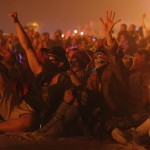 People cheer as the Man burns during the Burning Man 2013 arts and music festival in the Black Rock Desert of Nevada