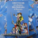 New edition of Venezuela's constitution are displayed with image of late president Chavez on cover, ready to be distributed, in Caracas