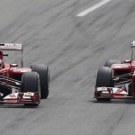 Ferrari Formula One driver Alonso drives ahead of team mate Massa during the Italian F1 Grand Prix at the Monza circuit