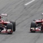 Ferrari Formula One driver Alonso drives ahead of team mate Massa during the Italian F1 Grand Prix at the Monza circuit