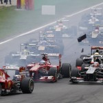 Ferrari's Massa overtakes Red Bull's Webber, with debris flying over the track as Lotus F1's Raikkonen contacts McLaren's Perez, at the start of the Italian F1 Grand Prix at the Monza circuit