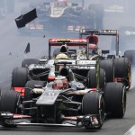 Debris fly as Lotus F1 Formula One driver Raikkonen collides with McLaren Formula One driver Perez at the start of the Italian F1 Grand Prix at the Monza circuit