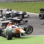 Force India Formula One driver Resta loses his front wheel after a collision with Lotus F1 Formula One driver Grosjean at the start of the Italian F1 Grand Prix at the Monza circuit