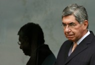 File picture shows Costa Rica's President Arias walking in his residence after a meeting in San Jose