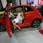A model poses inside a Fiat 500 E car during a media preview day at the Frankfurt Motor Show