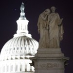 Statues of female figures representing Grief and History stand before the U.S. Capitol Dome on the grounds of the U.S. Capitol in Washington
