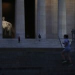 Early morning visitors to the Lincoln Memorial are pictured before sunrise in Washington