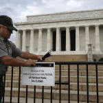 The National Park service's Richard Trott places a sign barring visitors to the Lincoln Memorial in Washington