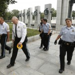 U.S. Park Police walk away after closing the World War II Memorial in Washington