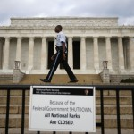 A National Parks policeman walks past a sign after the Lincoln Memorial was sealed off from visitors in Washington