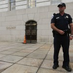 A U.S. Capitol Police officer blocks an entrance into the Longworth House Office Building on Capitol Hill in Washington