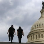 U.S. Capitol Police return to patrol after a brief meeting to discuss how to handle tourists turned away from the shuttered visitor's center at the U.S. Capitol in Washington
