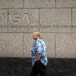 A woman walks past the NASA headquarters on Tuesday morning after the federal government was shutdown when the House and Senate failed to pass a budget in Washington