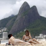 Women take off their tops as a protest, at Ipanema beach in Rio de Janeiro