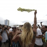 A woman takes off her top as a protest, at Ipanema beach in Rio de Janeiro