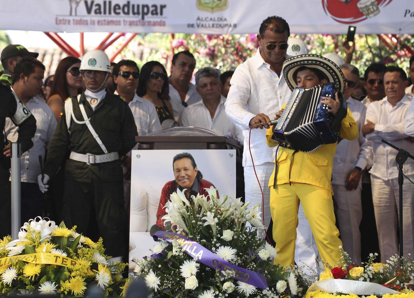 Child plays the accordion during a musical homage to musician Diomedes Diaz during a funeral ceremony at the main square of Valledupar