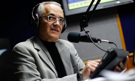 Reporter Bocaranda talks during his radio program in Caracas