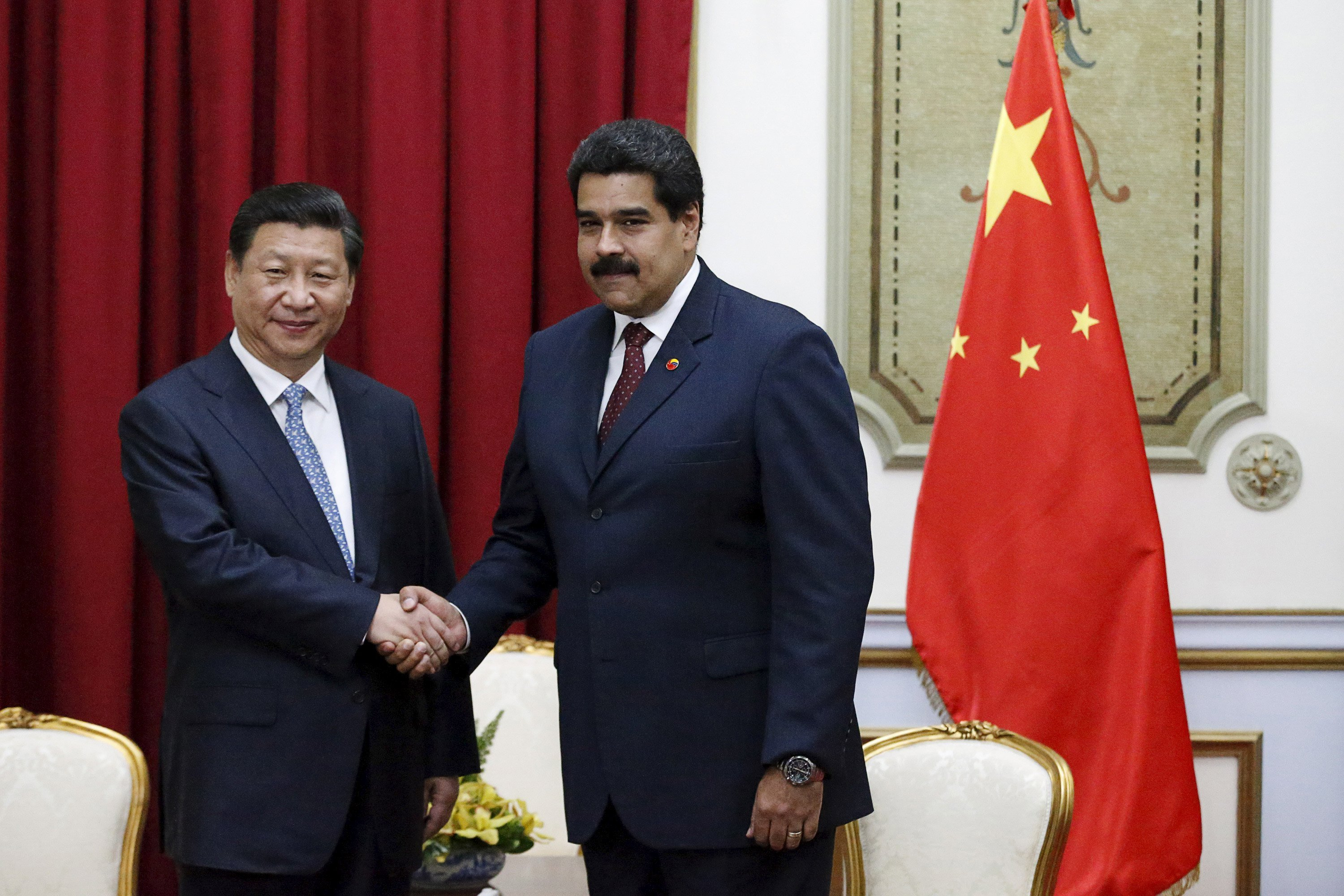 File photo of China's President Xi with Venezuela's President Maduro at a meeting in Miraflores Palace in Caracas