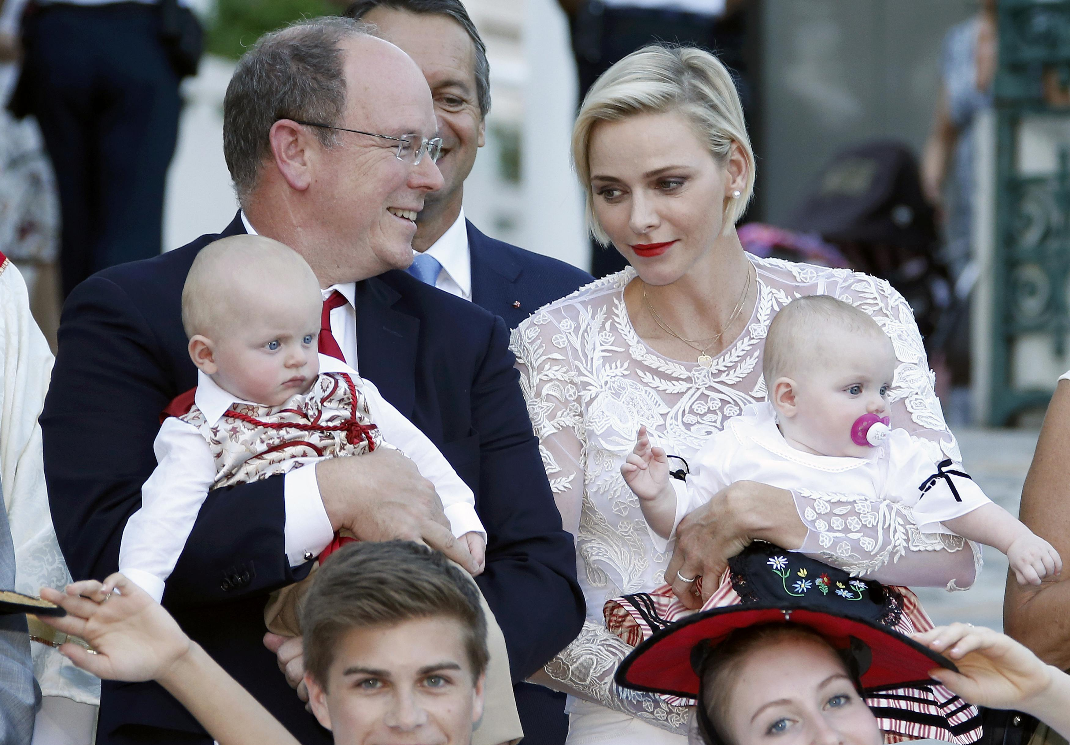 """Prince Albert II  and his wife Princess Charlene of Monaco arrive with their twins, Prince Jacques and Princess Gabriella, to take part in the traditional """"Pique Nique Monegasque"""" (Monaco's picnic) in Monaco"""