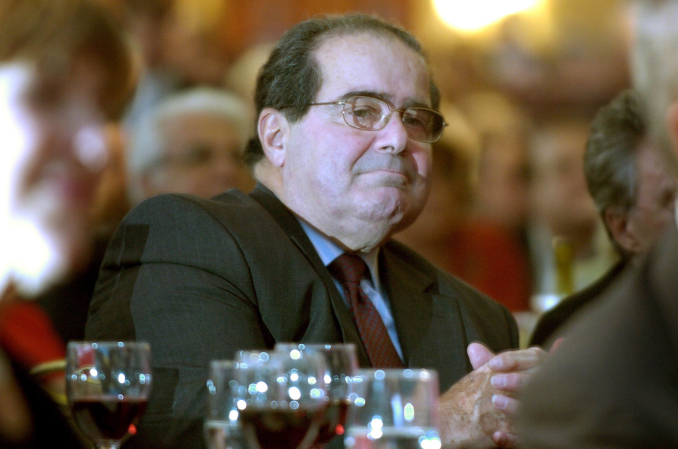 U.S. Supreme Court Justice Antonin Scalia sits in the audience at a National Italian American Foundation event in Washington, in this file photo taken October 20, 2006. Scalia, 79, has died, Texas Governor Greg Abbott said. Scalia, appointed to the top U.S. court in 1986 by President Ronald Reagan, was known for his strident conservative views and theatrical flair in the courtroom.   REUTERS/Jonathan Ernst/Files