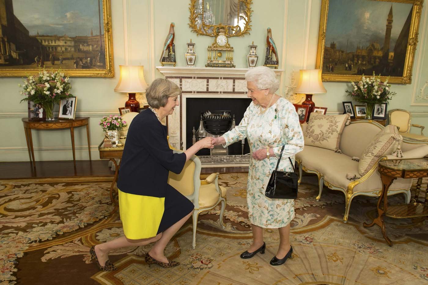 Britain's Queen Elizabeth welcomes Theresa May at the start of an audience in Buckingham Palace, where she invited her to become Prime Minister, in London July 13, 2016. REUTERS/Dominic Lipinski/Pool