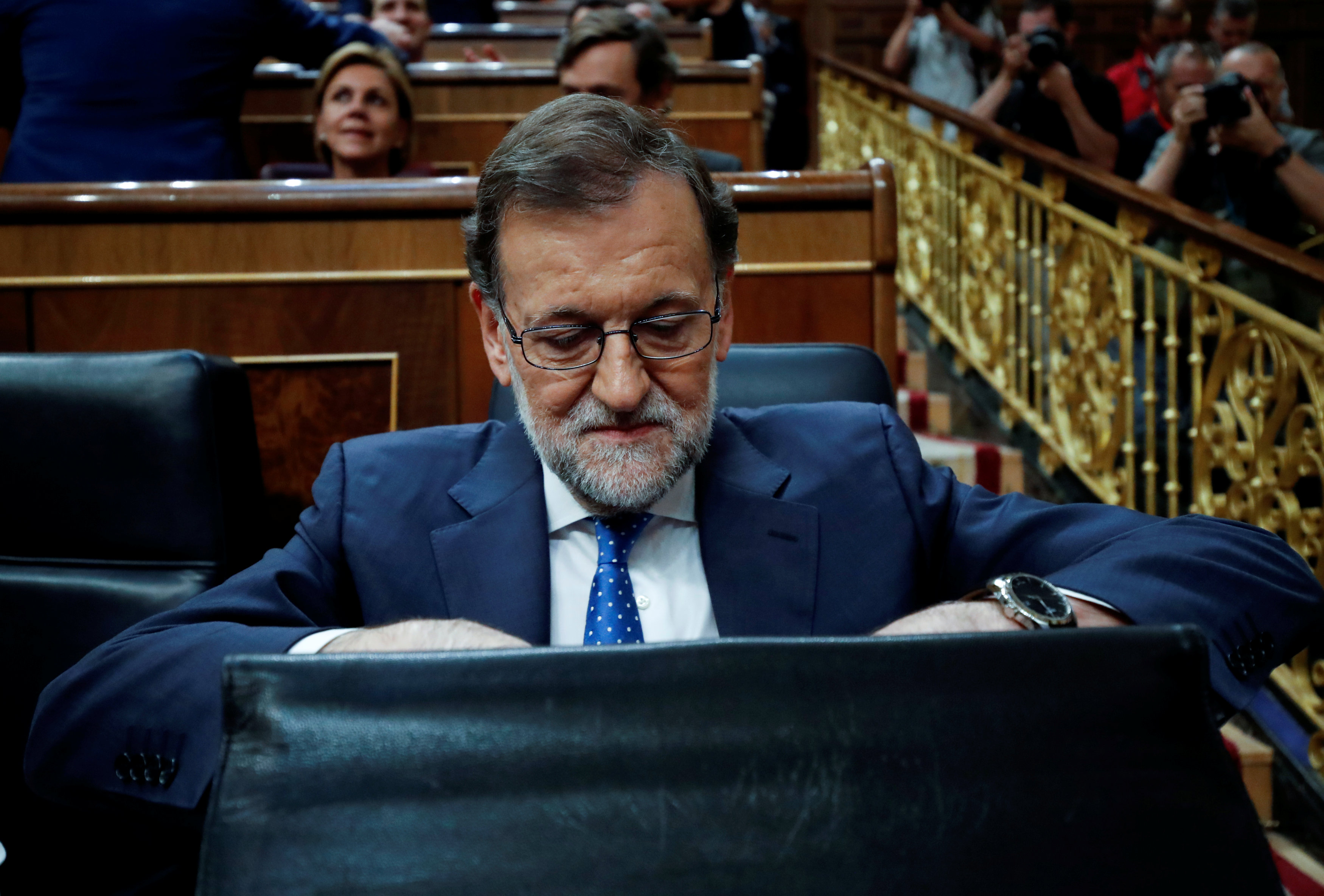 Spain's acting PM and People's Party (PP) leader Mariano Rajoy arrives for an investiture debate at parliament in Madrid, Spain, August 30, 2016.</body></html>