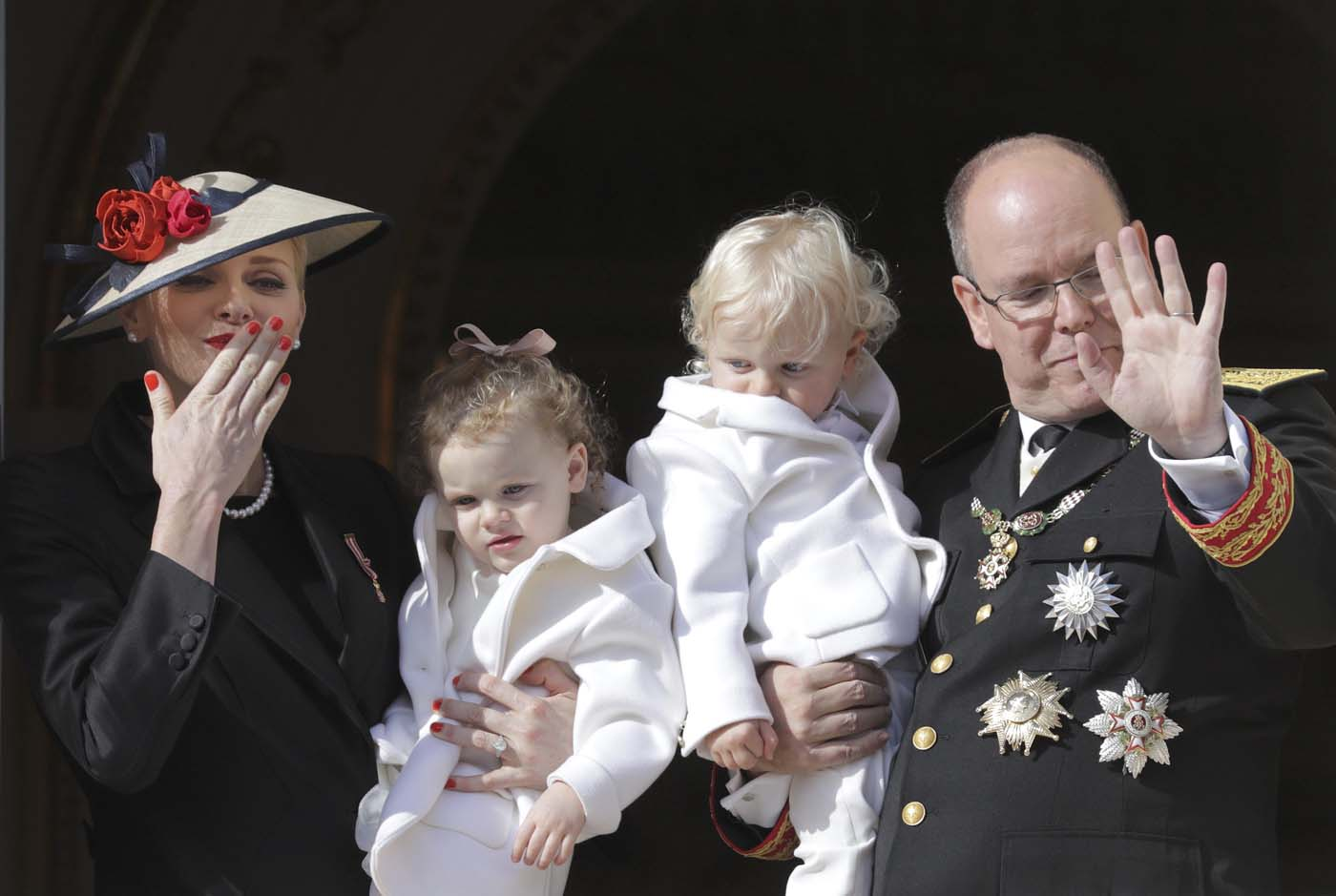 Prince Albert II of Monaco and his wife Princess Charlene hold their twins Prince Jacques and Princess Gabriella as they stand at the Palace Balcony during Monaco's National Day November 19, 2016. REUTERS/Eric Gaillard