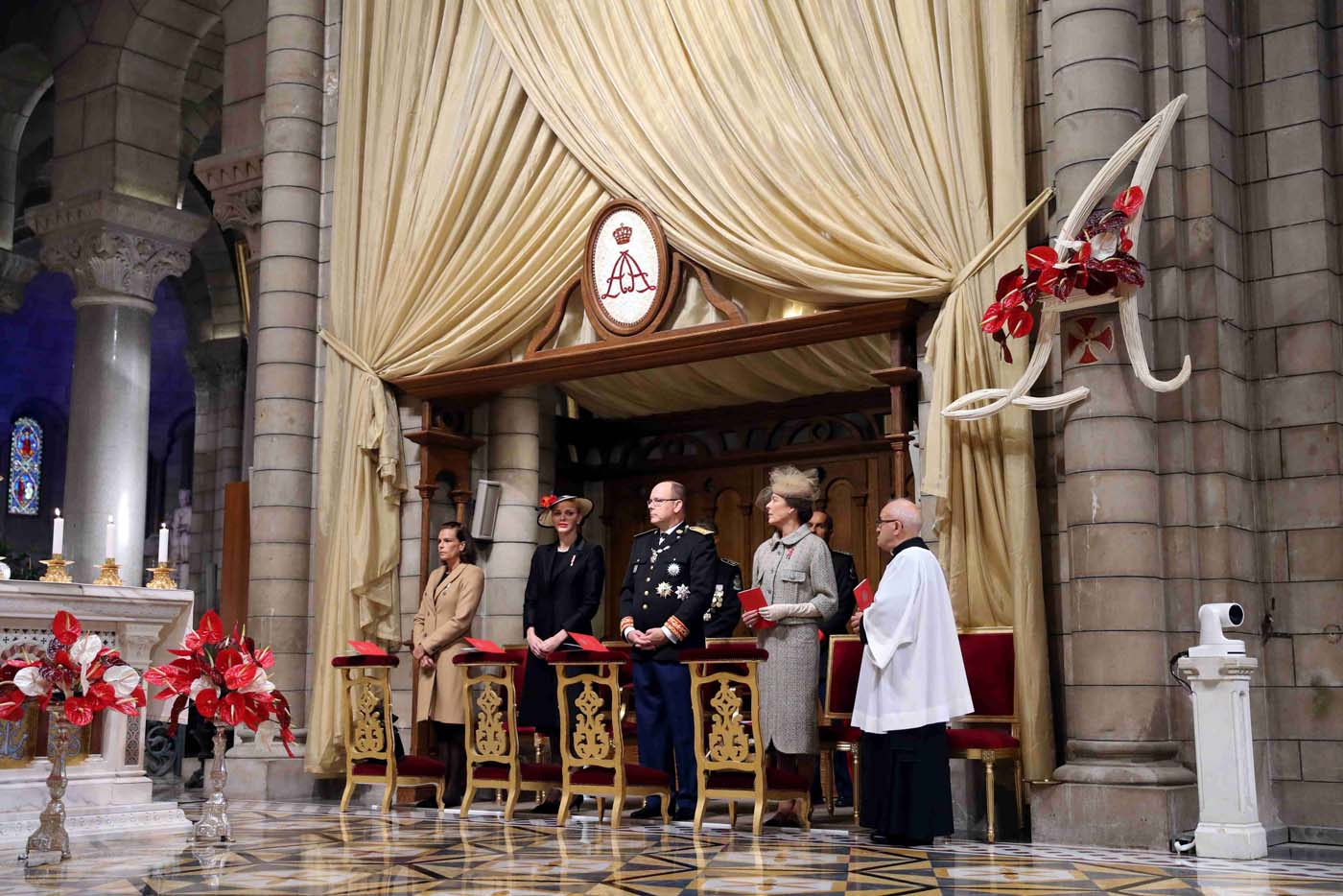 (LtoR) Princess Stephanie of Monaco, Princess Charlene of Monaco, Prince Albert II of Monaco and Princess Caroline of Hanover attend a mass at the Saint Nicholas Cathedral during the celebrations marking Monaco's National Day, on November 19, 2016 in Monaco. REUTERS/Valery Hache/Pool