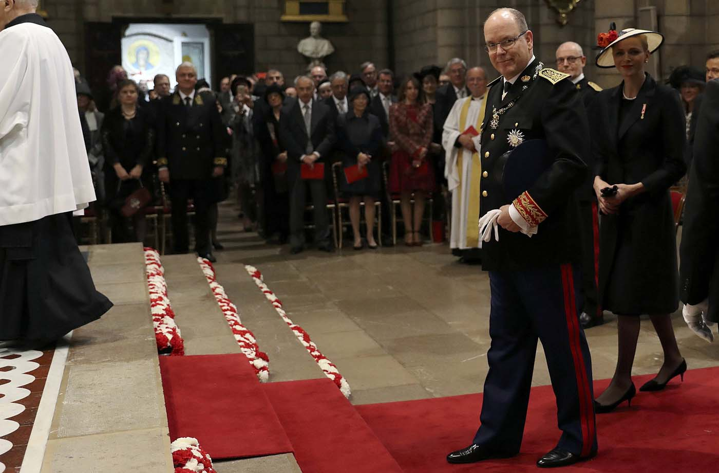 Prince Albert II of Monaco and Princess Charlene arrive for a mass at the Saint Nicholas Cathedral during the celebrations marking Monaco's National Day, on November 19, 2016 in Monaco. REUTERS/Valery Hache/Pool