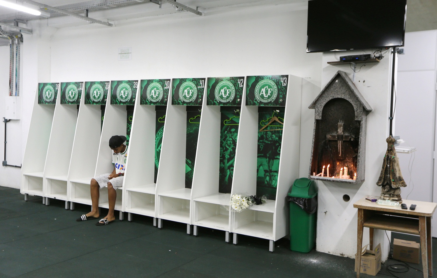 Leandro Bastos of Chapecoense's under-15 soccer team sits inside the team's locker room at the Arena Conda stadium in Chapeco, Brazil, November 29, 2016. REUTERS/Paulo Whitaker