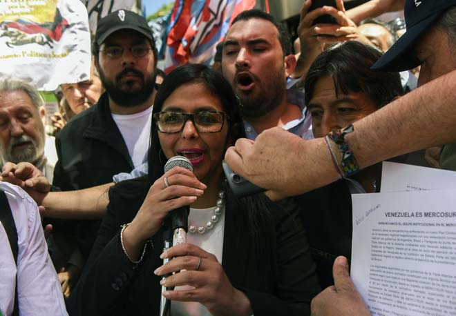 Venezuela's Foreign Minister Delcy Rodriguez, speaks to supporters outside the Argentine Foreign Ministry in Buenos Aires as Mercosur's ministers attend a meeting where Venezuela was not invited, on December 14, 2016. Mercosur's foreign ministers debate on Venezuela's suspension from the group after accusations that the leftist government in Caracas failed to meet democratic and trade standards. / AFP PHOTO / EITAN ABRAMOVICH