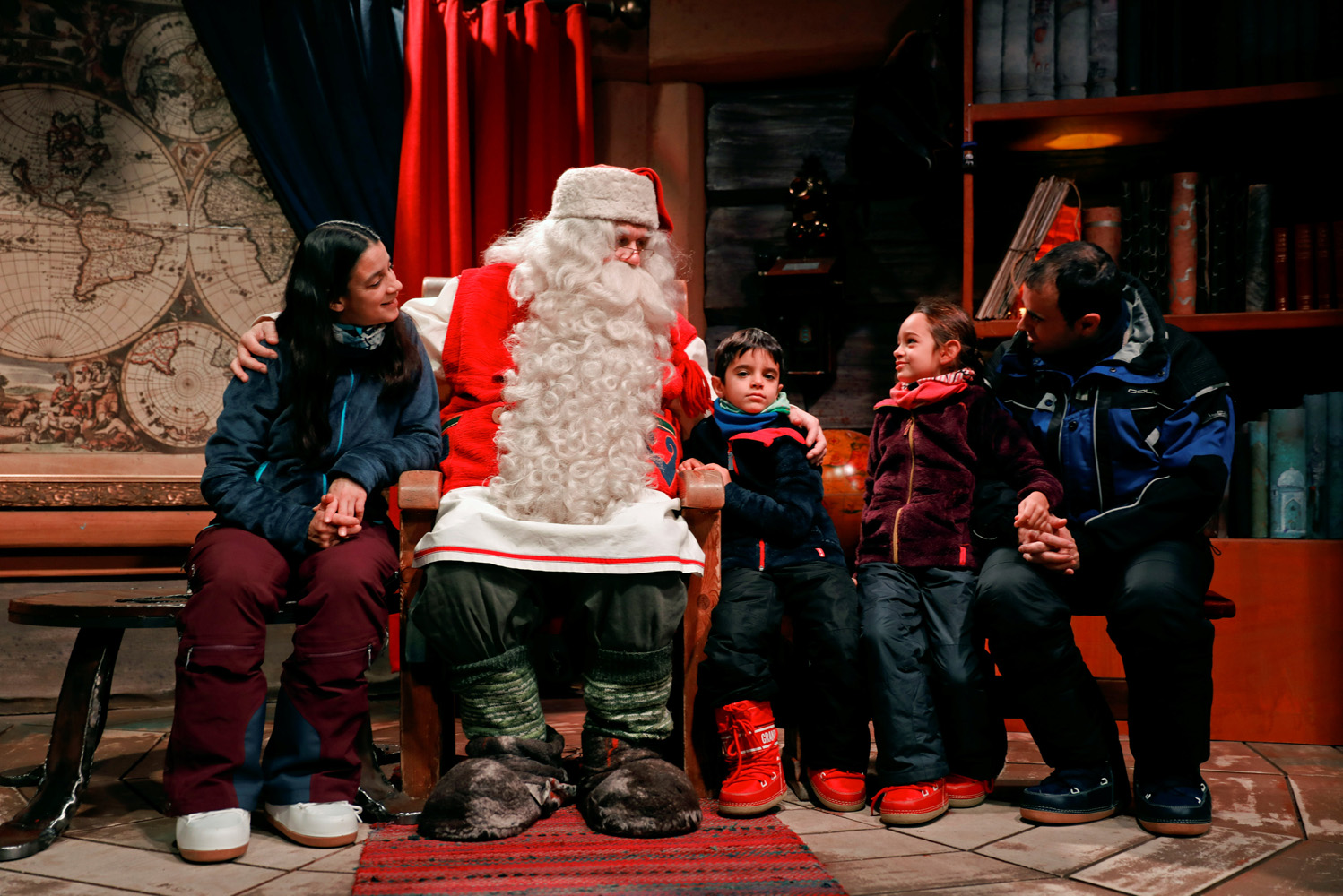 "Santa Claus talks to the Caballero family from Itay at Santa Claus' Village in the Arctic Circle near Rovaniemi, Finalnd December 15, 2016. REUTERS/Pawel Kopczynski SEARCH ""KOPCZYNSKI SANTA"" FOR THIS STORY. SEARCH ""THE WIDER IMAGE"" FOR ALL STORIES"