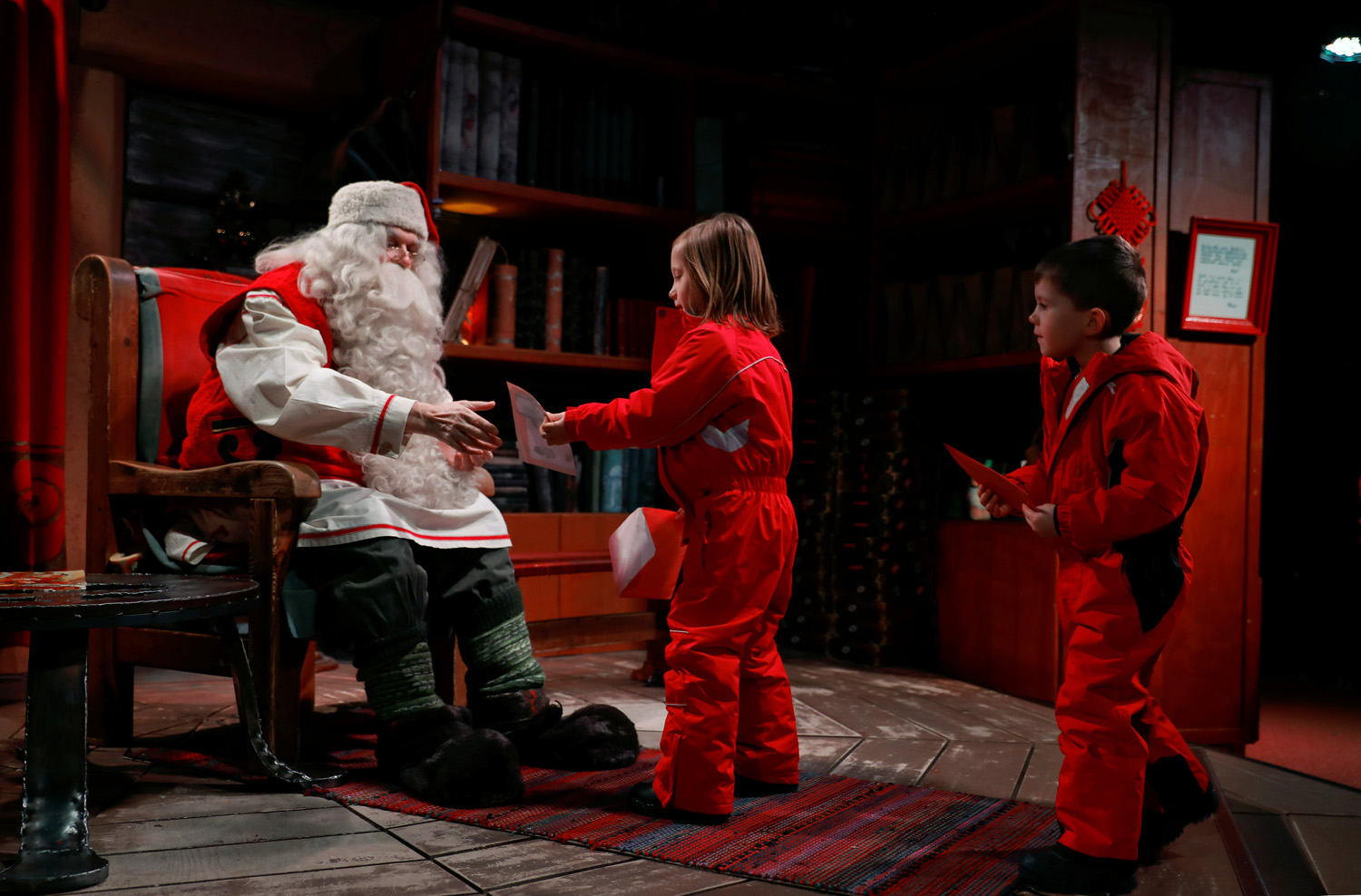 "Santa Claus talks to Eloise and Noah Seymour from England at Santa Claus' Village in the Arctic Circle near Rovaniemi, Finland December 15, 2016. REUTERS/Pawel Kopczynski SEARCH ""KOPCZYNSKI SANTA"" FOR THIS STORY. SEARCH ""THE WIDER IMAGE"" FOR ALL STORIES"