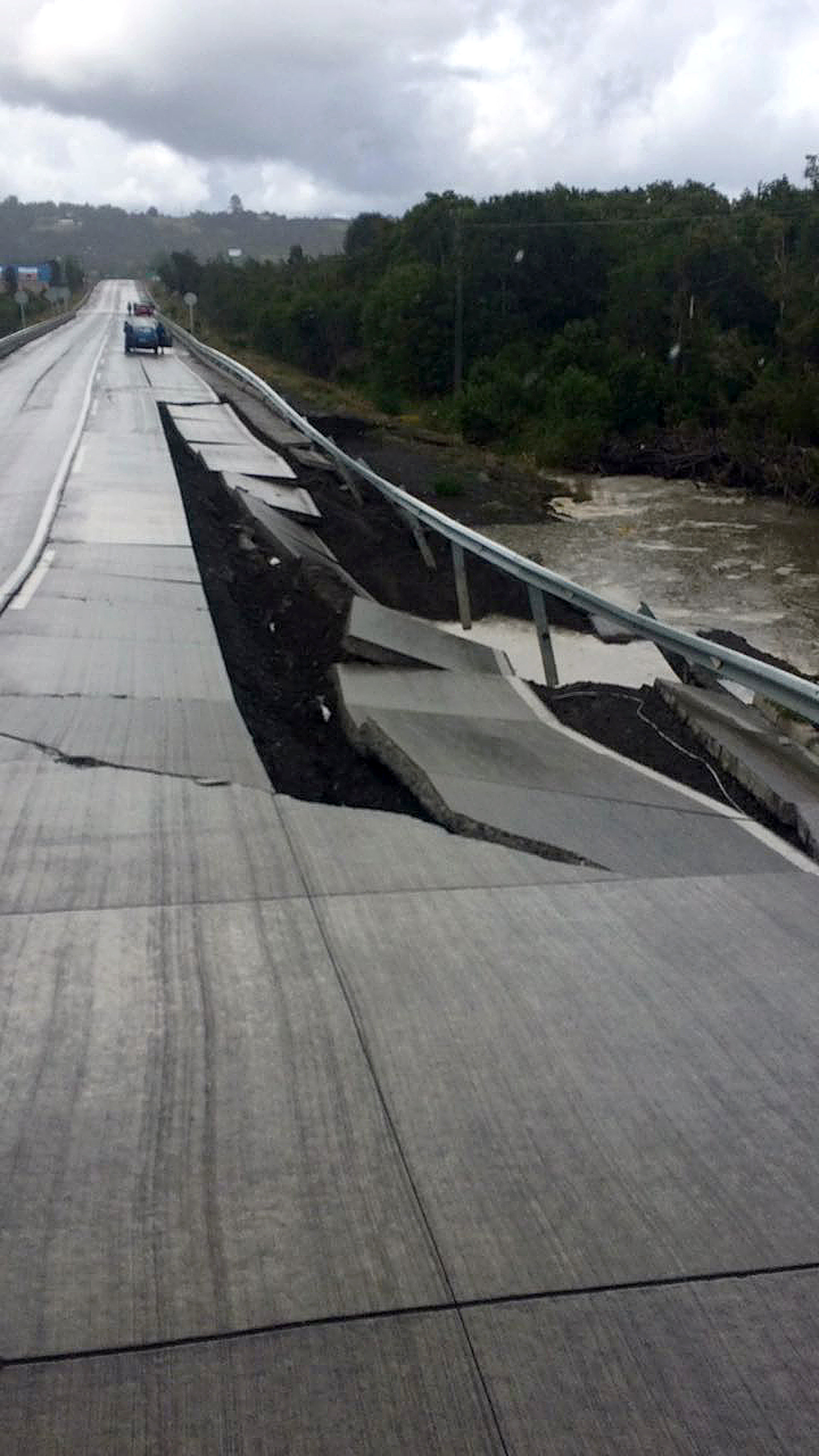 A damaged road is seen after a quake at Tarahuin, on Chiloe island, southern Chile, December 25, 2016. REUTERS/Alvaro Vidal EDITORIAL USE ONLY. NO RESALES.
