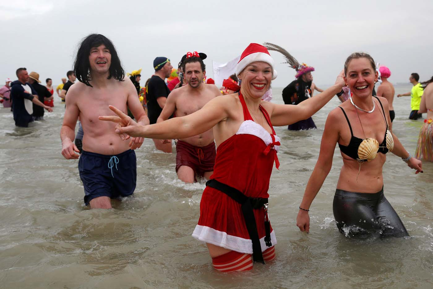 People wearing costumes participate in a traditional New Year's Day swim in Dunkirk, France January 1, 2017. REUTERS/Pascal Rossignol