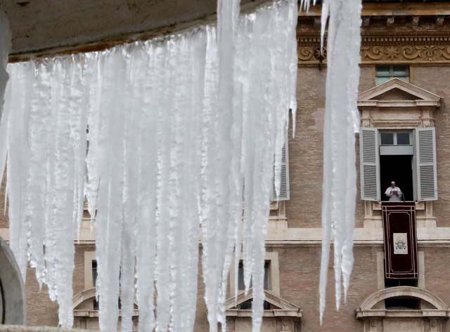 Ice covers a frozen fountain as Pope Francis leads his Sunday Angelus prayer in Saint Peter's square at the Vatican January 8, 2017. REUTERS/Tony Gentile