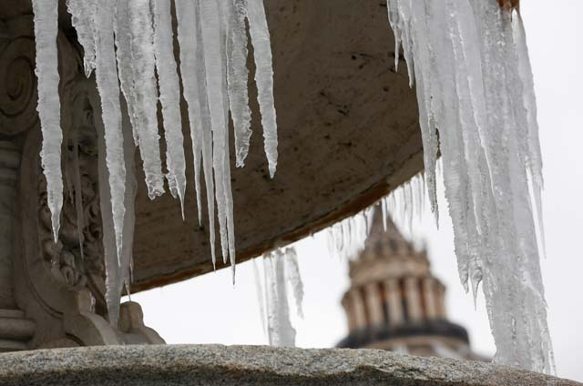 Ice covers a frozen fountain in Saint Peter's square at the Vatican January 8, 2017. REUTERS/Tony Gentile