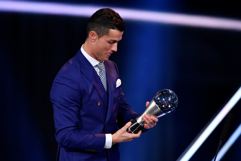 Real Madrid and Portugal's forward Cristiano Ronaldo holds his trophy after winning the The Best FIFA Men?s Player of 2016 Award during The Best FIFA Football Awards ceremony, on January 9, 2017 in Zurich. / AFP PHOTO / Fabrice COFFRINI