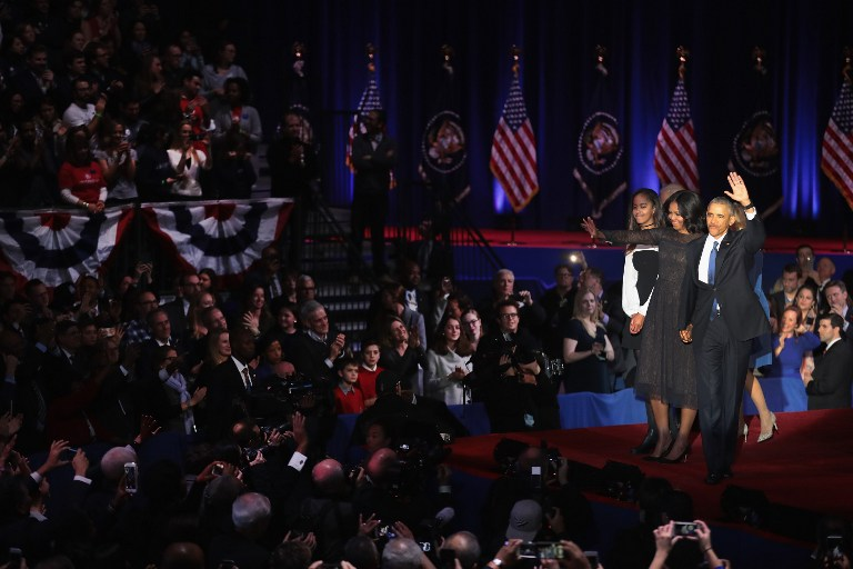CHICAGO, IL - JANUARY 10: President Barack Obama with his wife Michelle and daughter Malia greets the crowd the crowd following his farewell speech to the nation on January 10, 2017 in Chicago, Illinois. President-elect Donald Trump will be sworn in the as the 45th president on January 20. Scott Olson/Getty Images/AFP
