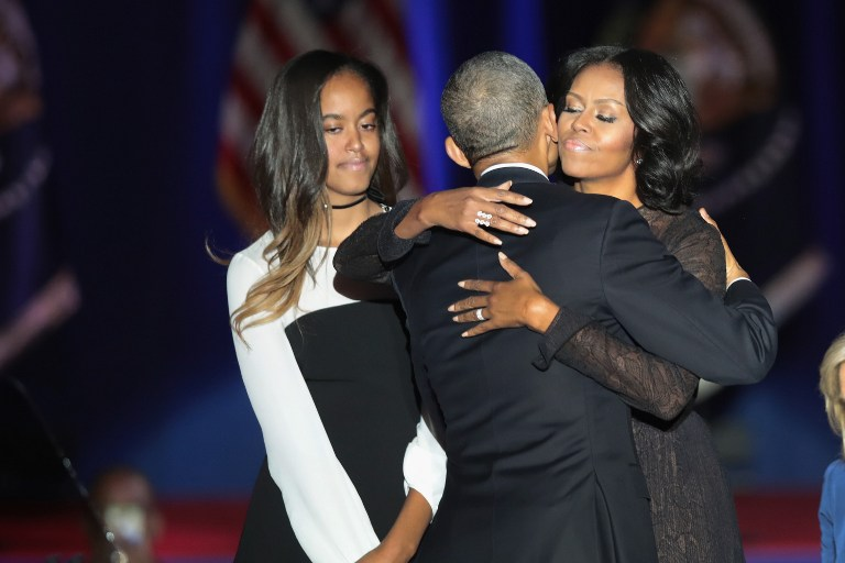 CHICAGO, IL - JANUARY 10: President Barack Obama embraces his wife Michelle and daughter Malia following his farewell speech to the nation on January 10, 2017 in Chicago, Illinois. President-elect Donald Trump will be sworn in the as the 45th president on January 20. Scott Olson/Getty Images/AFP