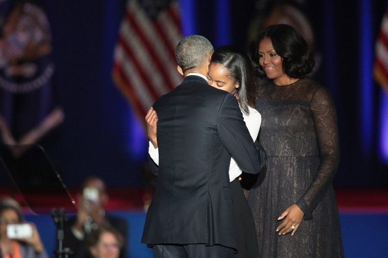 CHICAGO, IL - JANUARY 10: President Barack Obama greets his wife Michelle and daughter Malia following his farewell speech to the nation on January 10, 2017 in Chicago, Illinois. President-elect Donald Trump will be sworn in the as the 45th president on January 20. Scott Olson/Getty Images/AFP
