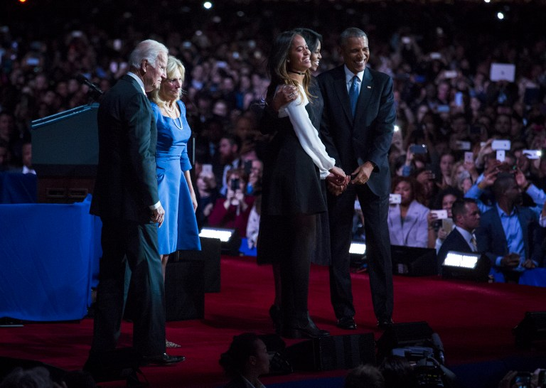 CHICAGO, IL - JANUARY 10: U.S. President Barack Obama, first lady Michelle Obama, daughter Malia Obama, Vice President Joe Biden and his wife Jill Biden stand on stage after Obama's farewell speech at McCormick Place on January 10, 2017 in Chicago, Illinois. Obama addressed the nation in what is expected to be his last trip outside Washington as president. President-elect Donald Trump will be sworn in as the 45th president on January 20. Darren Hauck/Getty Images/AFP