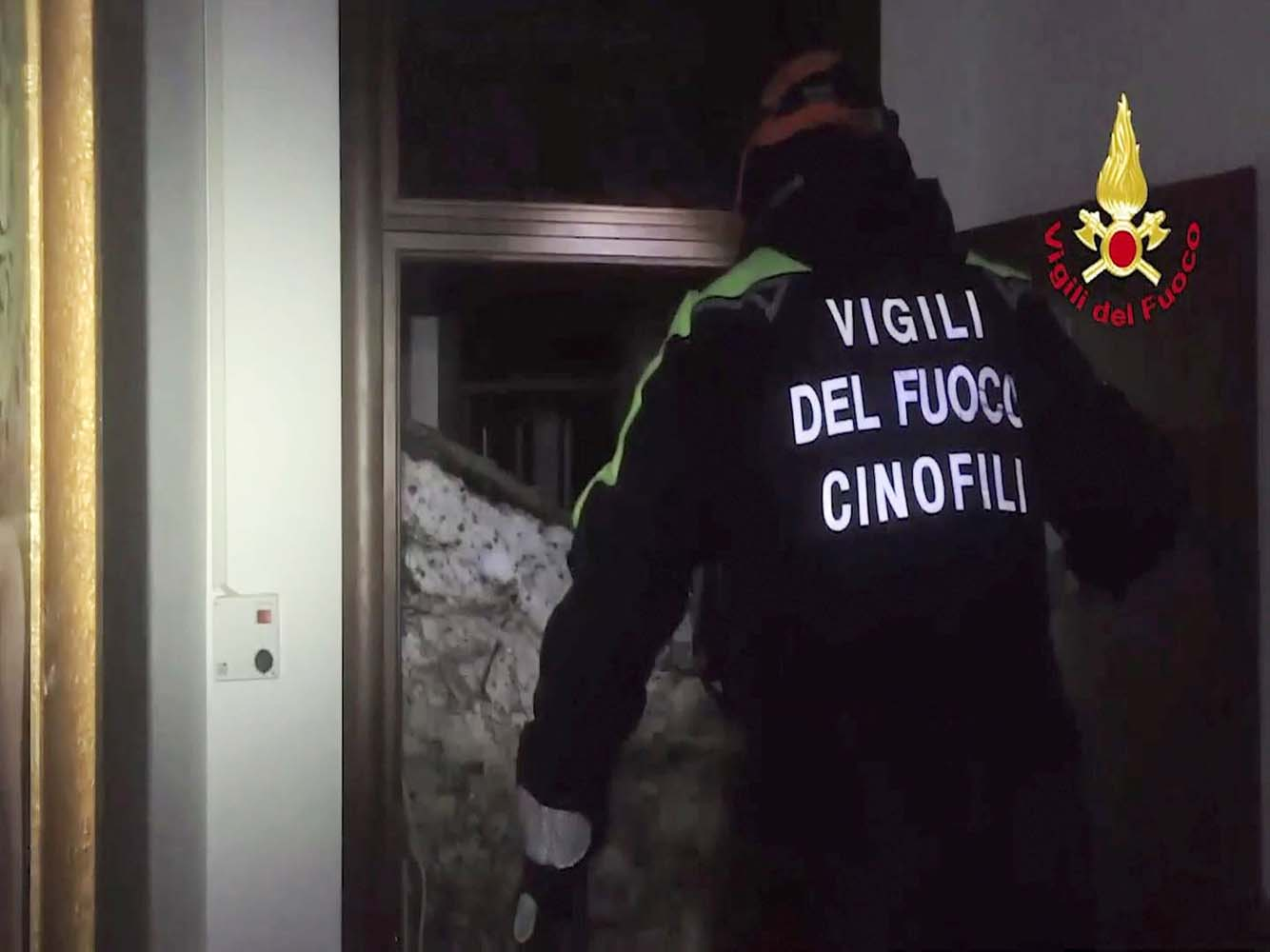 A still image taken from a video shows a firefighter working at Hotel Rigopiano in Farindola, central Italy, after it was hit by an avalanche, January 20, 2017 provided by Italy's Fire Fighters. Vigili del Fuoco/Handout via REUTERS ATTENTION EDITORS - THIS IMAGE WAS PROVIDED BY A THIRD PARTY. EDITORIAL USE ONLY.