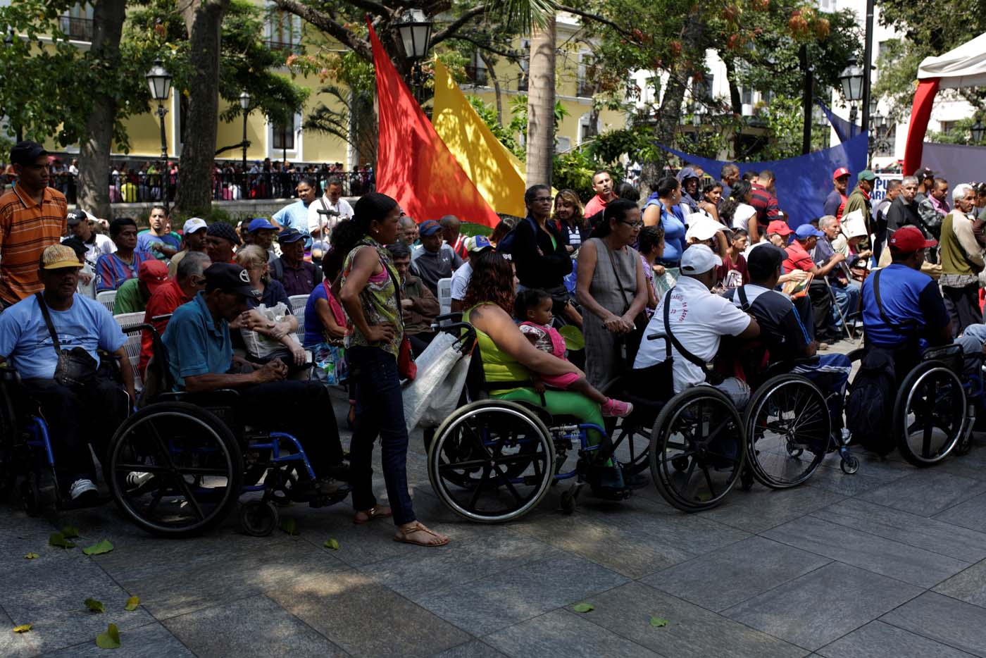 People on wheelchairs wait to apply for a card that will register them for government social programmes, in Caracas, Venezuela January 20, 2017. REUTERS/Marco Bello