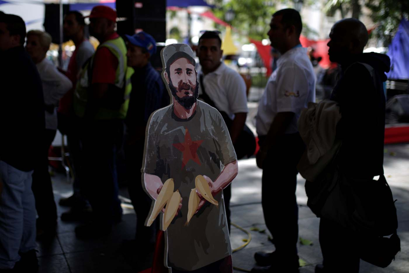 A cardboard cut-out of Cuba's late President Fidel Castro is seen as people wait to apply for a card that will register them for government social programmes, in Caracas, Venezuela January 20, 2017. REUTERS/Marco Bello